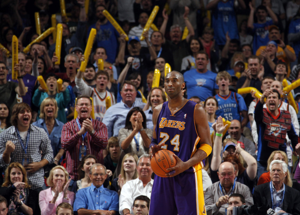 Photo - Fans cheer after Lakers' Kobe Bryant (24) is called for a charge during the NBA basketball game between the Oklahoma City Thunder and the Los Angeles Lakers, Sunday, Feb. 27, 2011, at the Oklahoma City Arena.Photo by Sarah Phipps, The Oklahoman