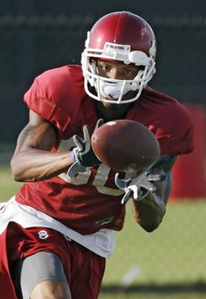 Adron  Tennell catches a pass during the University of Oklahoma football practice on Monday, Aug. 17, 2009, in Norman, Okla. Photo by Chris Landsberger
