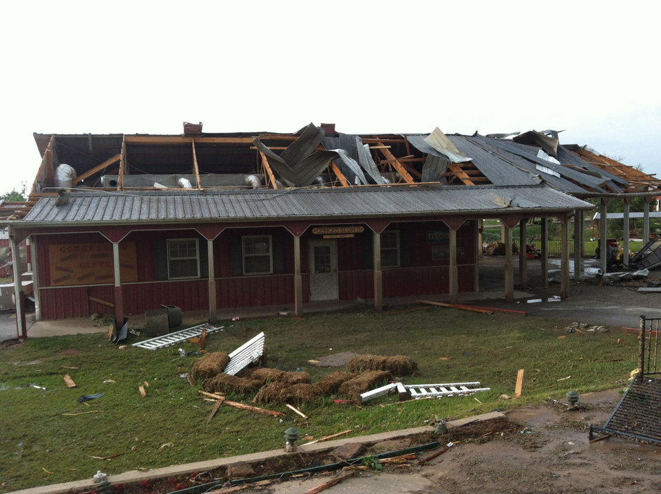 AFTER: The Train Station, pictured here after the tornado hit it on May 20, sustained a large amount of damage to the roof and overhang adjacent to the historic carousel.. PHOTO PROVIDED.  <strong></strong>