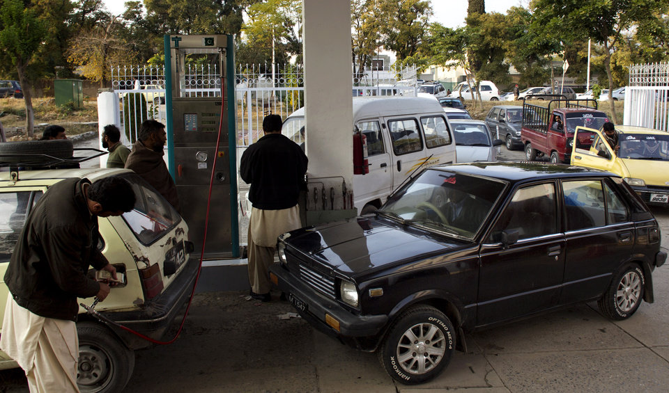 In this Tuesday, Dec. 11, 2012 photo, Drivers queue at a gas station in Islamabad, Pakistan. It has become a familiar site across Pakistan in recent weeks: Long lines of cars and minibuses snaking for hundreds of yards as their frustrated drivers wait to fill up their tanks with natural gas. (AP Photo/B.K. Bangash)