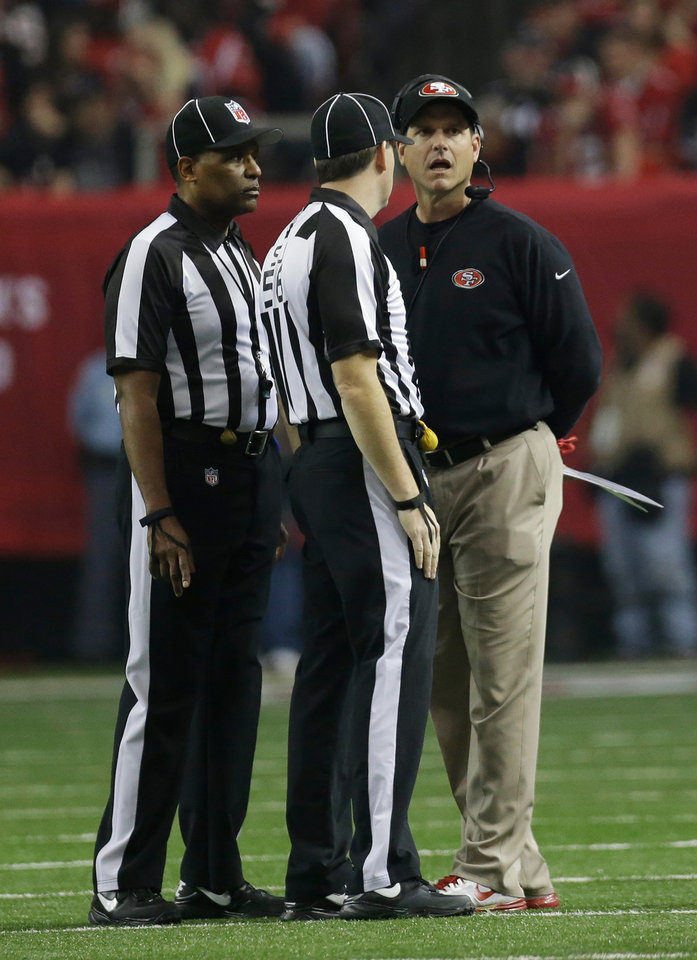 Photo - San Francisco 49ers head coach Jim Harbaugh argues a call during the first half of the NFL football NFC Championship game against the Atlanta Falcons Sunday, Jan. 20, 2013, in Atlanta. (AP Photo/Dave Martin)