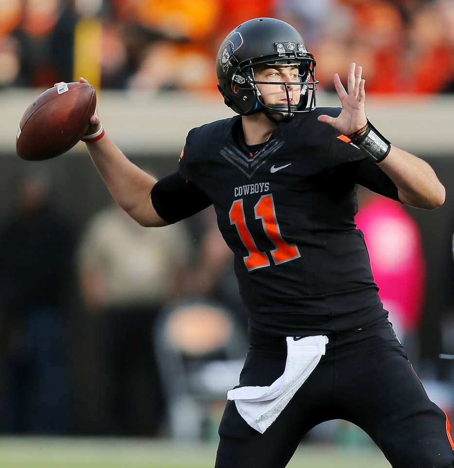 Photo - Oklahoma State's Wes Lunt (11) passes in the third quarter during a college football game between Oklahoma State University (OSU) and Texas Christian University (TCU) at Boone Pickens Stadium in Stillwater, Okla., Saturday, Oct. 27, 2012. OSU won, 36-14. Photo by Nate Billings, The Oklahoman