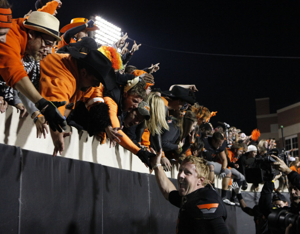 Photo - Oklahoma State's Brandon Weeden (3) celebrates with fans during a college football game between the Oklahoma State University Cowboys (OSU) and the Kansas State University Wildcats (KSU) at Boone Pickens Stadium in Stillwater, Okla., Saturday, Nov. 5, 2011.  Photo by Sarah Phipps, The Oklahoman