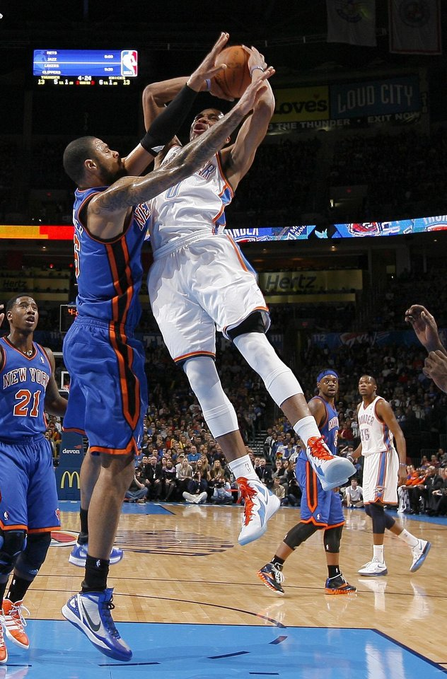 Photo - Oklahoma City's Russell Westbrook (0) runs into Tyson Chandler (6) during the NBA game between the Oklahoma City Thunder and the New York Knicks at Chesapeake Energy Arena in Oklahoma CIty, Saturday, Jan. 14, 2012. Photo by Bryan Terry, The Oklahoman