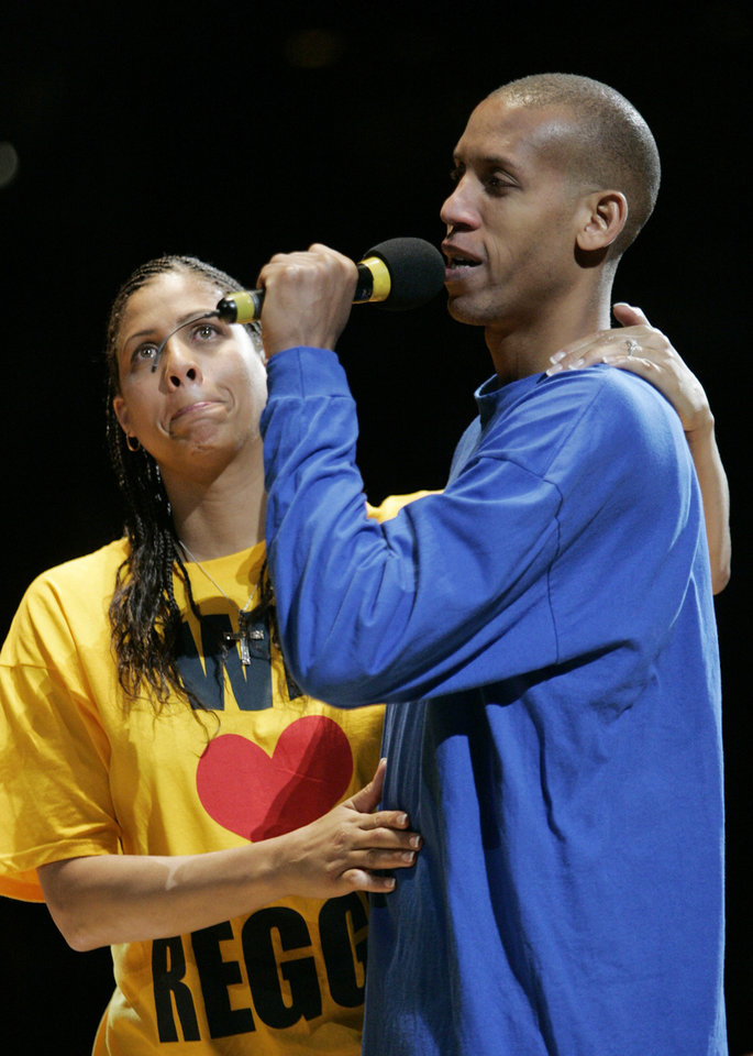 NBA BASKETBALL, RETIRE, RETIREMENT: Indiana Pacers guard Reggie Miller, right, is comforted by his sister, Cheryl Miller, as he speaks to fans during a ceremony following their game against the Chicago Bulls in Indianapolis, Wednesday, April 20, 2005. Miller was honored by the Pacers after his last regular season home game. (AP Photo/Tom Strattman)