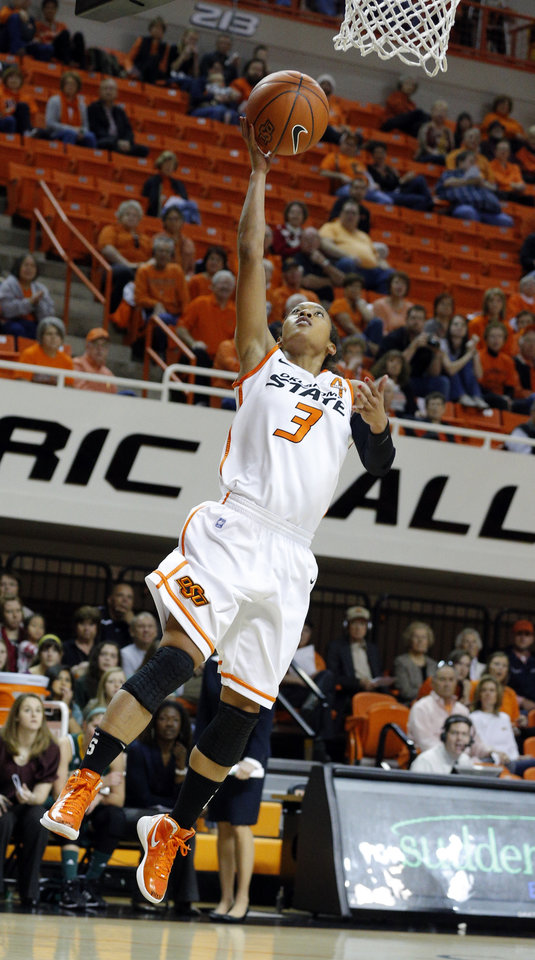 Photo - Oklahoma State's Tiffany Bias (3) shoots a lay up during the women's college basketball game between Oklahoma State University and Vermont at Gallagher-Iba Arena in Stillwater, Okla., Sunday,Dec. 16, 2012. Photo by Sarah Phipps, The Oklahoman