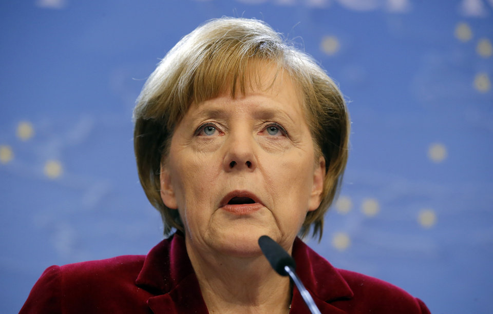Photo - German Chancellor Angela Merkel speaks during a media conference after an EU summit in Brussels on Thursday, March 6, 2014. European Union leaders are holding an emergency summit to decide on imposing sanctions against Russia over its military incursion in Ukraine's Crimean peninsula. (AP Photo/Michel Euler)