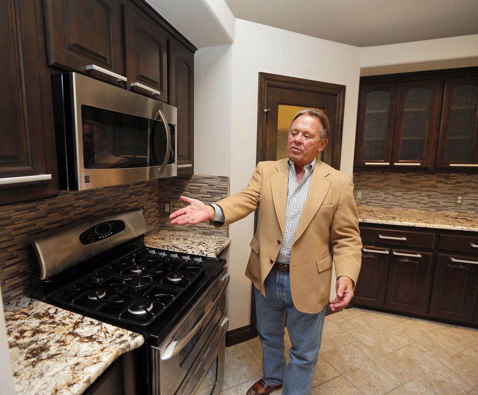Developer and builder Tom Jordan talks about the kitchen in a model home at 13736 SE 95 in his Foxmor Estates neighbohood. The addition is southeast of SE 89 and Hiwassee Road.