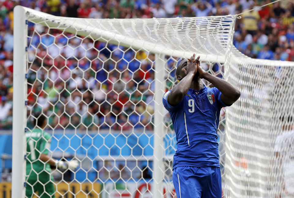 Photo - Italy's Mario Balotelli reacts after missing a chance during the group D World Cup soccer match between Italy and Costa Rica at the Arena Pernambuco in Recife, Brazil, Friday, June 20, 2014.  (AP Photo/Frank Augstein)