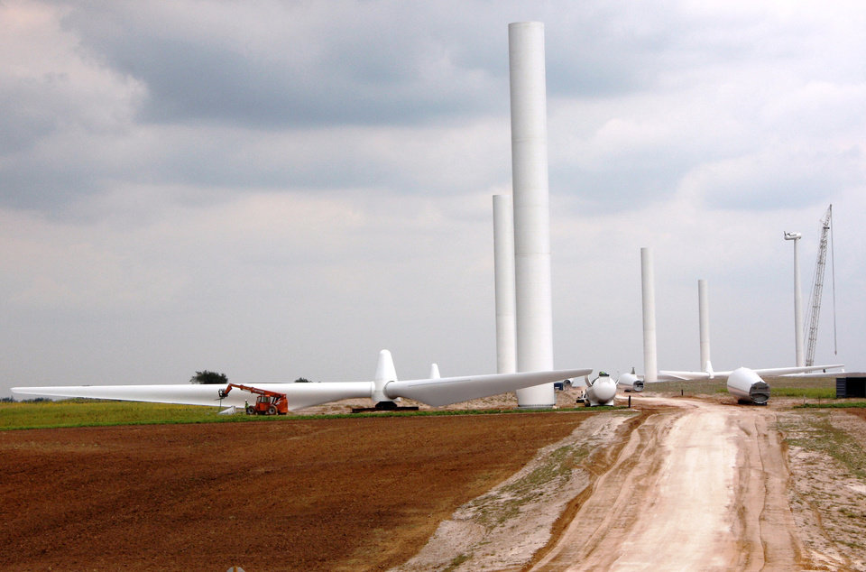 Photo - Parts of wind turbines lay on the road ready to be put together for the OU Spirit wind farm. Photo provided