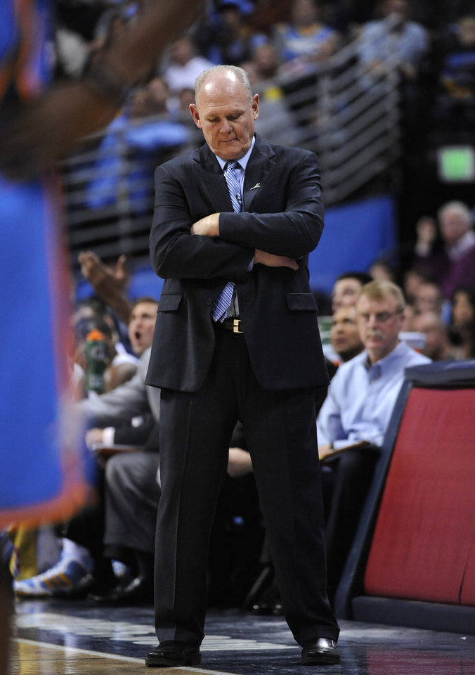 Denver Nuggets head coach George Karl hangs his head during the first half of game 3 of a first-round NBA basketball playoff series against the Oklahoma City Thunder Saturday, April 23, 2011, in Denver. (AP Photo/Jack Dempsey)