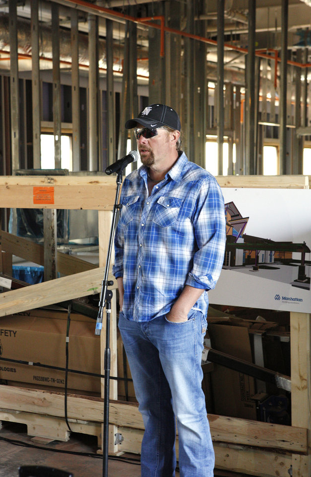 Photo - Toby Keith speaks to construction workers Monday at the OK Kids Korral, 818 NE 8, in Oklahoma City. Photo by Paul B. Southerland, The Oklahoman  PAUL B. SOUTHERLAND - PAUL B. SOUTHERLAND