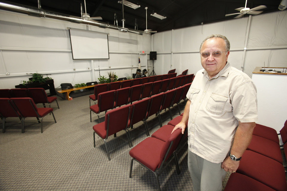 Rev.  Gary Barnhart stands in the new building for the Abundant Praise Church of God in Kingfisher, Oklahoma August 23 , 2010. Photo by Steve Gooch, The Oklahoman
