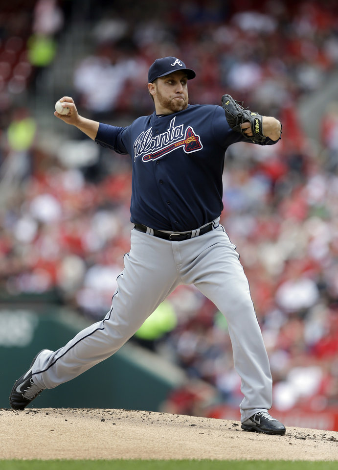 Photo - Atlanta Braves starting pitcher Aaron Harang throws against the St. Louis Cardinals during the first inning of a baseball game on Saturday, May 17, 2014, in St. Louis. (AP Photo/Jeff Roberson)