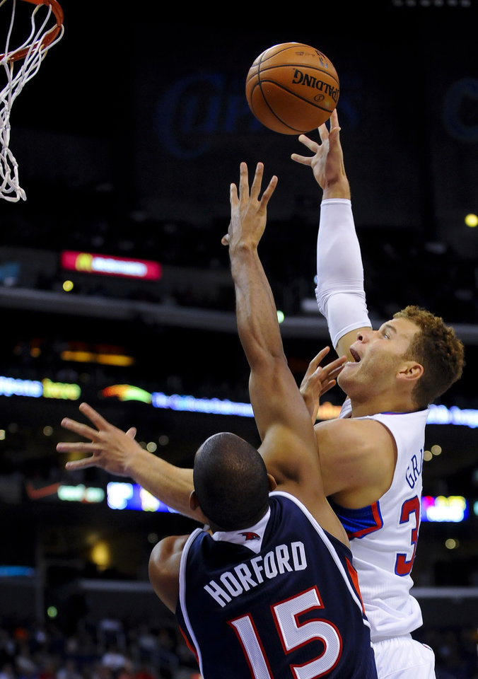 Los Angeles Clippers forward Blake Griffin, right, drives on Atlanta Hawks forward Al Horford (15), of the Dominican Republic, for a basket in the first half of an NBA basketball game on Sunday, Nov. 11, 2012, in Los Angeles. (AP Photo/Gus Ruelas)