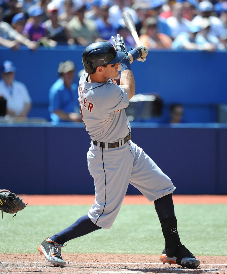 Photo - Detroit Tigers' Ian Kinsler hits a double, scoring Andrew Romine in the fourth inning against the Toronto Blue Jays  during a baseball game on Sunday, Aug. 10, 2014, in Toronto. (AP Photo/The Canadian Press, Jon Blacker)