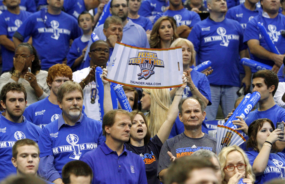 An Oklahoma City fan cheers during game 2 of the Western Conference Finals in the NBA basketball playoffs between the Dallas Mavericks and the Oklahoma City Thunder at American Airlines Center in Dallas, Thursday, May 19, 2011. Photo by Bryan Terry, The Oklahoman