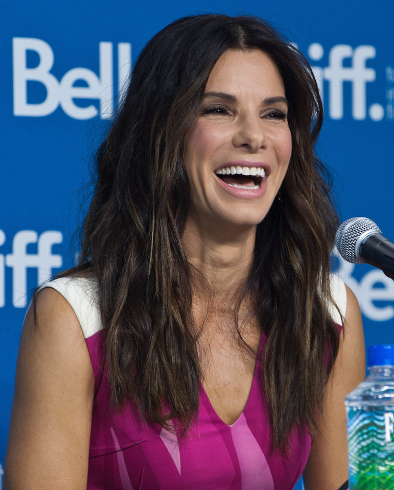 "Photo - Actress Sandra Bullock laughs during the press conference for ""Gravity"" at the 2013 Toronto International Film Festival in Toronto on Monday, Sept. 9, 2013. (AP Photo/The Canadian Press, Galit Rodan) ORG XMIT: GYR108"