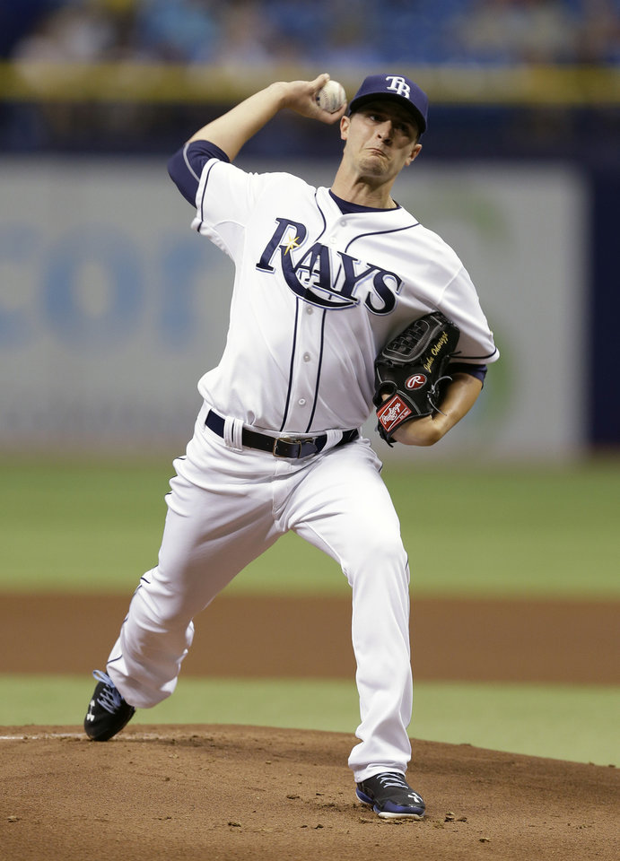 Photo - Tampa Bay Rays starting pitcher Jake Odorizzi delivers to the Miami Marlins during the first inning of an interleague baseball game Thursday, June 5, 2014, in St. Petersburg, Fla. (AP Photo/Chris O'Meara)