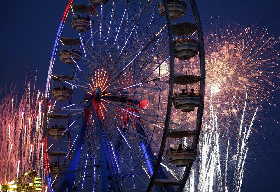 Photo - Fireworks explode over the Electric Daisy Carnival, Friday, June 20, 2014, in Las Vegas. Fireworks and rides, including 5 Ferris wheels, add to the carnival atmosphere of the electronic dance music festival. (AP Photo/John Locher)
