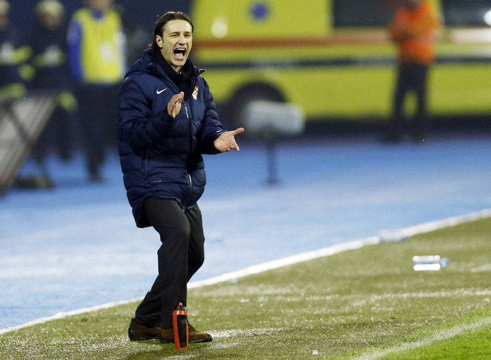 Photo - FILE - In this Nov. 19, 2013, file photo, Croatia's head coach Niko Kovac instructs his players during their World Cup qualifying playoff second leg soccer match against Iceland, in Zagreb, Croatia. Kovak already knows it won't be at full strength for the difficult opener against Brazil. (AP Photo/Darko Bandic, File, File)