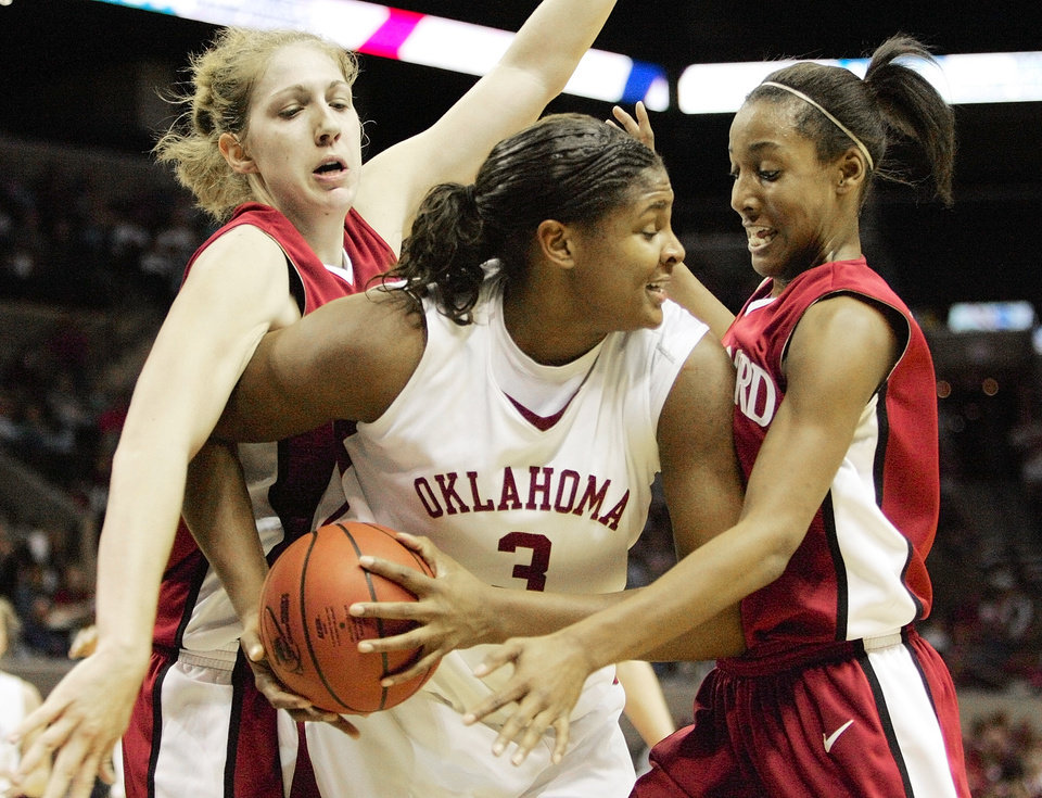 Photo - NCAA TOURNAMENT, WOMEN'S COLLEGE BASKETBALL: Stanford's Kristen Newlin (43), left, and Candice Wiggins (11), right, double team  OU's Courtney Paris (3) in the first half during the University of Oklahoma Sooners against the Stanford Cardinals in their regional semifinal game of the NCAA Women's Basketball Championship at the AT&T Center in San Antonio, Texas, Saturday, March 25, 2006. Stanford defeated the Sooners, 88-74. By Nate Billings, The Oklahoman