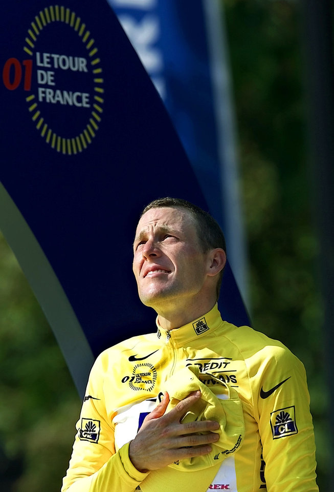 Photo - FILE - In this July 29, 2001, file photo, Lance Armstrong stands during ceremonies after winning the Tour de France cycling race following the 20th and final stage in Paris. Armstrong confessed to using performance-enhancing drugs to win the Tour de France during a taped interview with Oprah Winfrey that aired Thursday, Jan. 17, 2013, reversing more than a decade of denial. (AP Photo/Laurent Rebours, File)