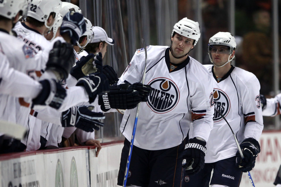 Photo - Edmonton Oilers' Dustin Penner, middle, is congratulated by teammates after scoring a goal against the Anaheim Ducks during the second period of an NHL hockey game on Friday March 27, 2009, in Anaheim, Calif. (AP Photo/Jeff Lewis)