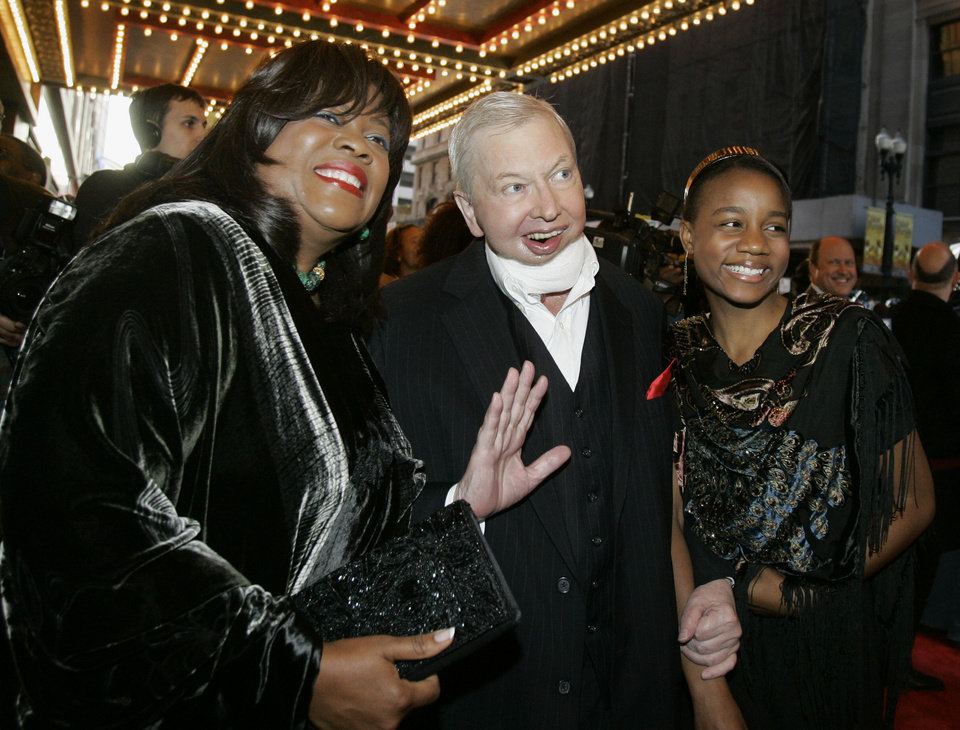 Photo - ADVANCE FOR USE SUNDAY, DEC. 22 AND THEREAFTER - FILE - In this May 3, 2007 file photo, film critic Roger Ebert, center, his wife Chaz, left, and their granddaughter Raven Evans, right, arrive for the Chicago premiere of the the Broadway hit