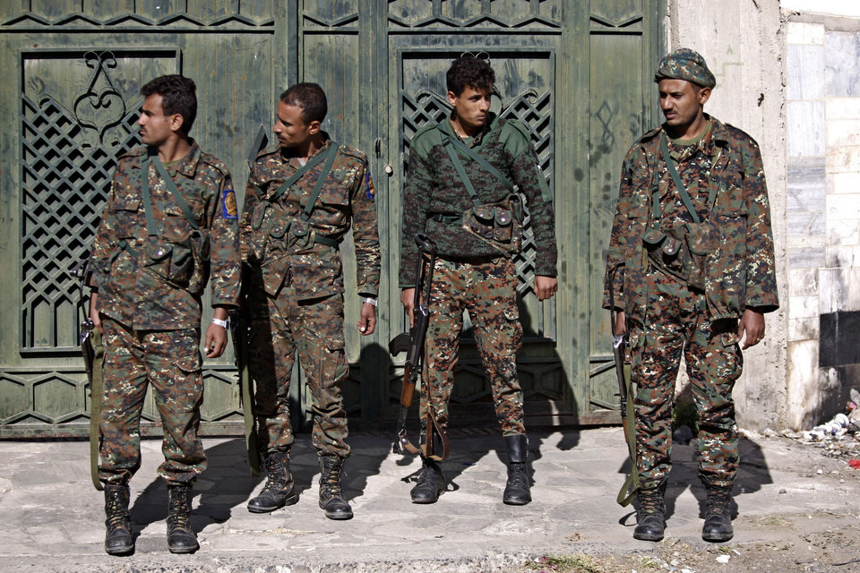 Yemeni soldiers stand guard outside a state security court during a trial of suspected al-Qaida militants in Sanaa, Yemen, Sunday, Jan. 6, 2013. Yemen's state security court has sentenced five alleged al-Qaida militants to up to 10 years in prison for carrying out attacks against security forces and supporting the group logistically in the southern province of Abyan in 2011. (AP Photo/Hani Mohammed)