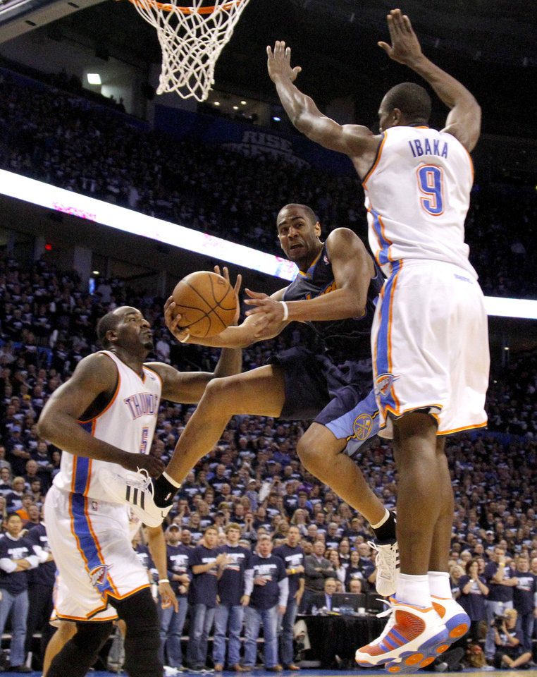 Photo - Denver's Arron Afflalo (6) goes between Oklahoma City's Kendrick Perkins (5) and Serge Ibaka (9)during the NBA basketball game between the Denver Nuggets and the Oklahoma City Thunder in the first round of the NBA playoffs at the Oklahoma City Arena, Wednesday, April 27, 2011. Photo by Bryan Terry, The Oklahoman