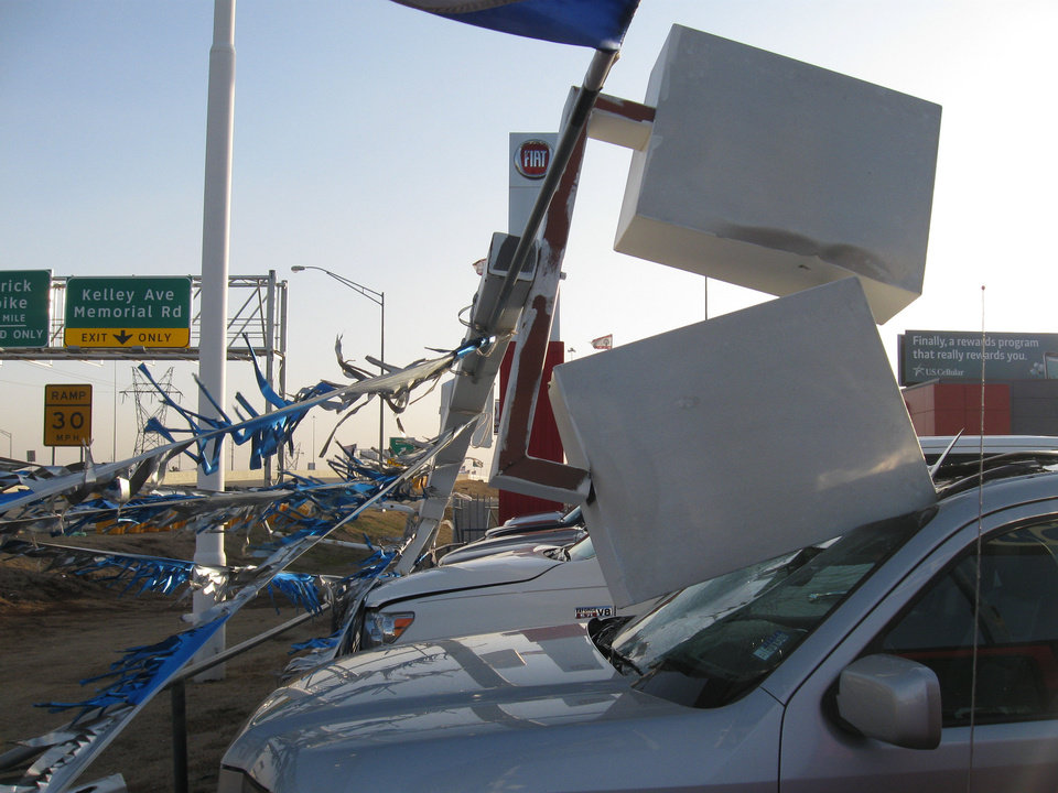 High winds toppled light poles onto vehicles at  Edmond Hyundai on the Broadway Extension in  Edmond Monday afternoon.  Photo BY MATT DINGER, the oklahoman
