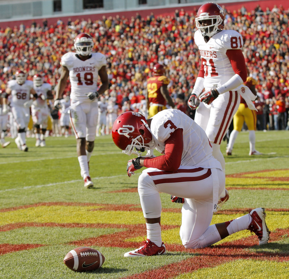 Photo - Oklahoma's Sterling Shepard (3) reacts near Lacoltan Bester (81) and Justin Brown (19) after scoring a touchdown in the second quarter during a college football game between the University of Oklahoma (OU) and Iowa State University (ISU) at Jack Trice Stadium in Ames, Iowa, Saturday, Nov. 3, 2012. Photo by Nate Billings, The Oklahoman