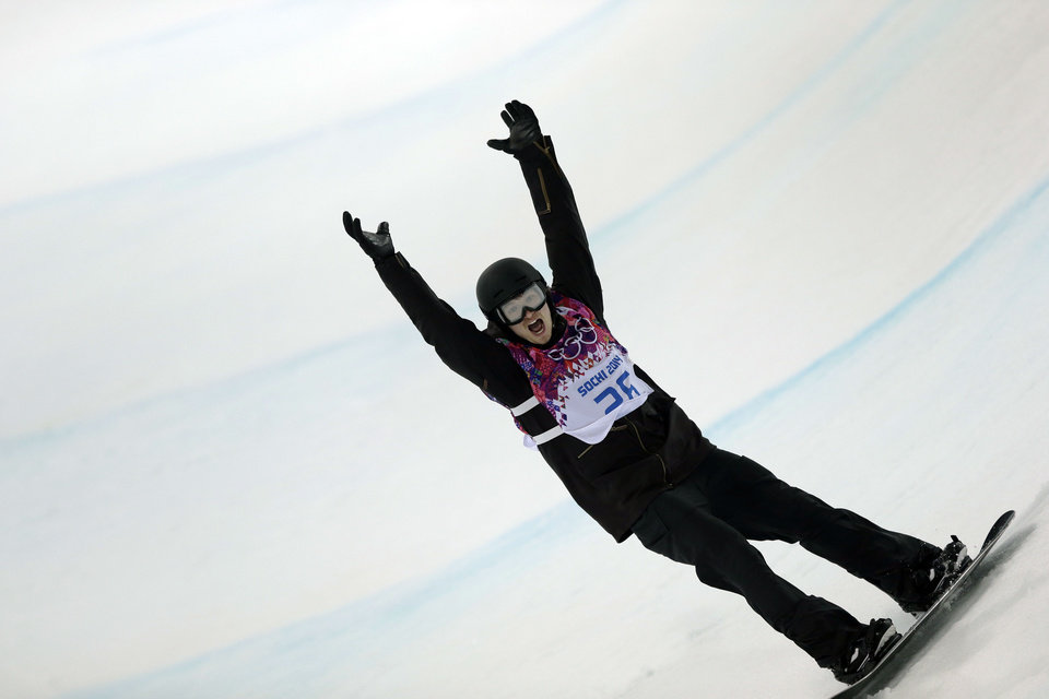Photo - Switzerland's Iouri Podladtchikov celebrates after his second half pipe run during the men's snowboard halfpipe final at the Rosa Khutor Extreme Park, at the 2014 Winter Olympics, Tuesday, Feb. 11, 2014, in Krasnaya Polyana, Russia. Podladtchikov won the gold medal. (AP Photo/Andy Wong)