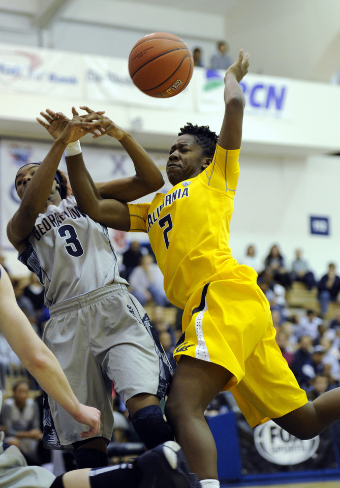 Photo - California guard Afure Jemerigbe (2) gets fouled by Georgetown guard Tyshell King (3) during the first half of an NCAA women's college basketball game, Sunday, Nov. 17, 2013, in Washington. (AP Photo/Nick Wass)