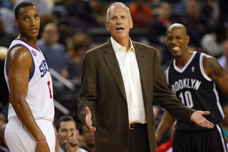 Philadelphia 76ers head coach Doug Collins, center, questions a call during an NBA preseason basketball game against the Brooklyn Nets in Atlantic City , N.J., Saturday, Oct. 13, 2012. The Nets defeated the 76ers 108-105 in overtime. (AP Photo/Rich Schultz)