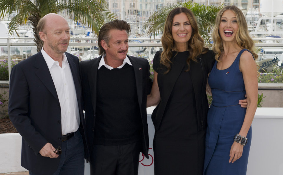 Photo -   From left, filmmaker Paul Haggis, actors Sean Penn, Roberta Armani and model Petra Nemcova pose during a photo call for the Haiti Carnival charity event at the 65th international film festival, in Cannes, southern France, Friday, May 18, 2012. (AP Photo/Jonathan Short)