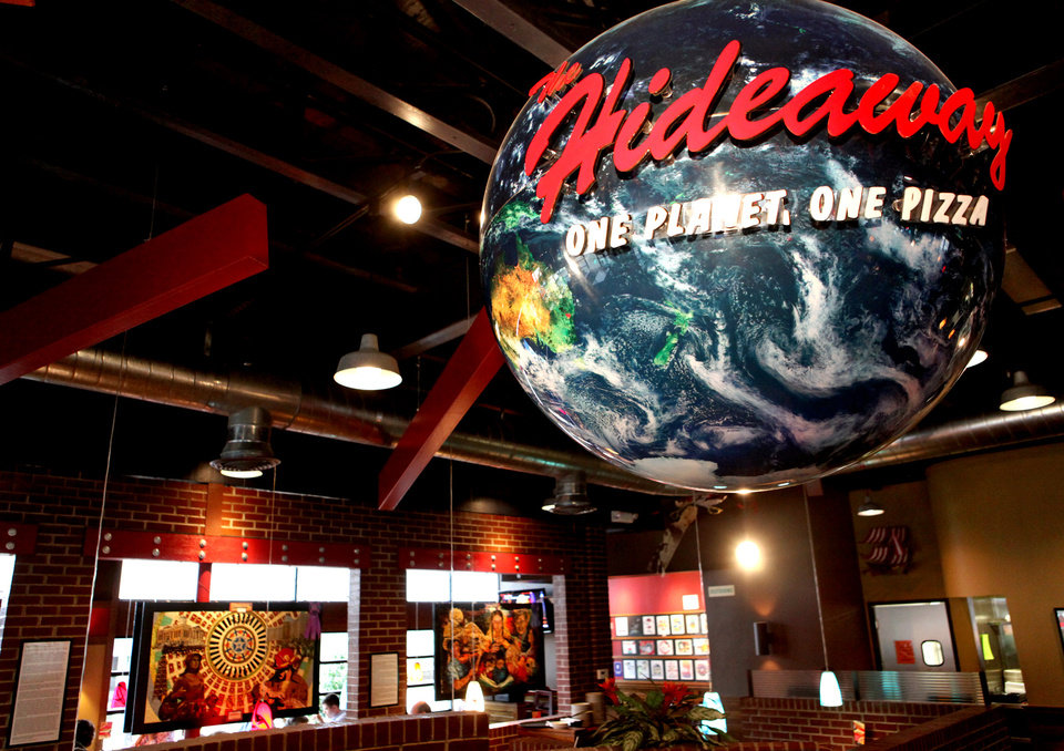 Photo - Collages and a large globe hang inside the Hideaway Pizza restaurant on Northwest Expressway in northwest Oklahoma City on Tuesday, March 3, 2009. By John Clanton, The Oklahoman ORG XMIT: KOD