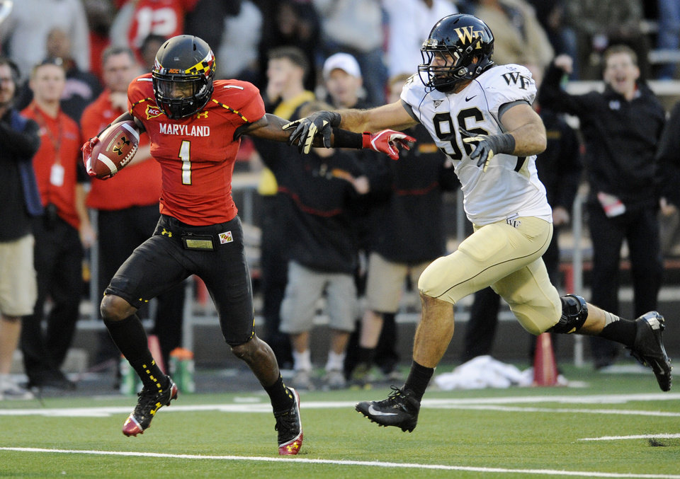 Photo -   Maryland wide receiver Stefon Diggs (1) runs with the ball after a catch for a 63 yard gain against Wake Forest defensive end Hasan Hazime (96) during the second half of an NCAA football game, Saturday, Oct. 6, 2012, in College Park, Md. Maryland won 19-14. (AP Photo/Nick Wass)