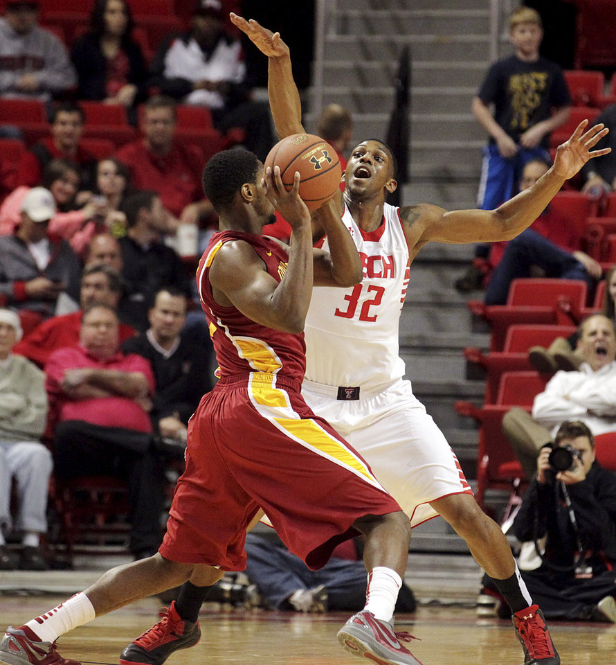 Photo - Iowa State's Melvin Ejim is defended by Texas Tech's Jordan Tolbert (32) during their NCAA college basketball game, Wednesday, Jan. 23, 2013, in Lubbock, Texas. (AP Photo/The Avalanche-Journal, Stephen Spillman) ALL LOCAL TV OUT