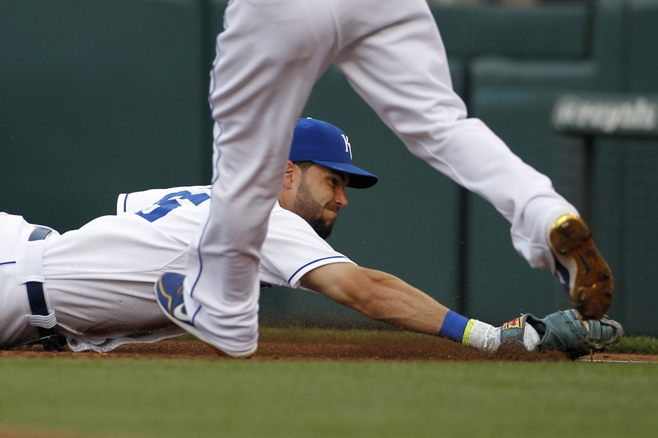 Photo - Kansas City Royals first baseman Eric Hosmer dives toward the bag after catching a ground ball hit by Los Angeles Dodgers' Andre Ethier in the second inning of a baseball game at Kauffman Stadium in Kansas City, Mo., Monday, June 23, 2014.  Ethier was called out on the play. (AP Photo/Colin E. Braley)