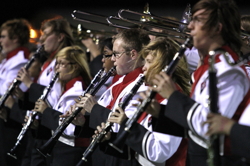 Photo - The Carl Albert band plays before the Carl Albert Titans - Ardmore Tigers football game Friday night at Jim Harris stadium in Midwest City. PHOTO BY HUGH SCOTT, FOR THE OKLAHOMAN