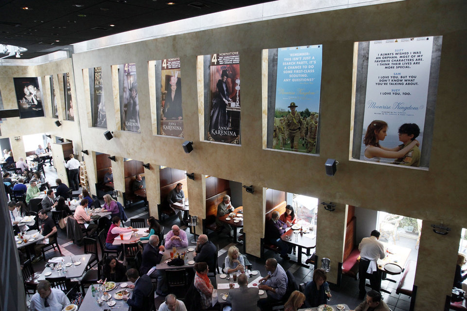 This Thursday, Feb. 21, 2013 photo shows people having lunch beneath Oscar posters at Kate Mantilini restaurant in Beverly Hills, Calif. The 85th Academy Awards are held on Sunday, Feb. 24, 2013, in Los Angeles. (AP Photo/Nick Ut)