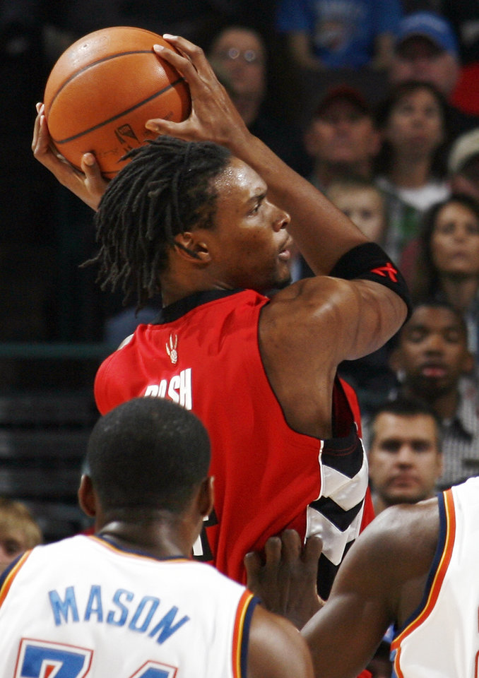 Toronto's Chris Bosh moves to the hoop past Desmond Mason of Oklahoma City during the NBA basketball game between the Toronto Raptors and the Oklahoma City Thunder at the Ford Center in Oklahoma City, Friday, Dec. 19, 2008. BY NATE BILLINGS, THE OKLAHOMAN