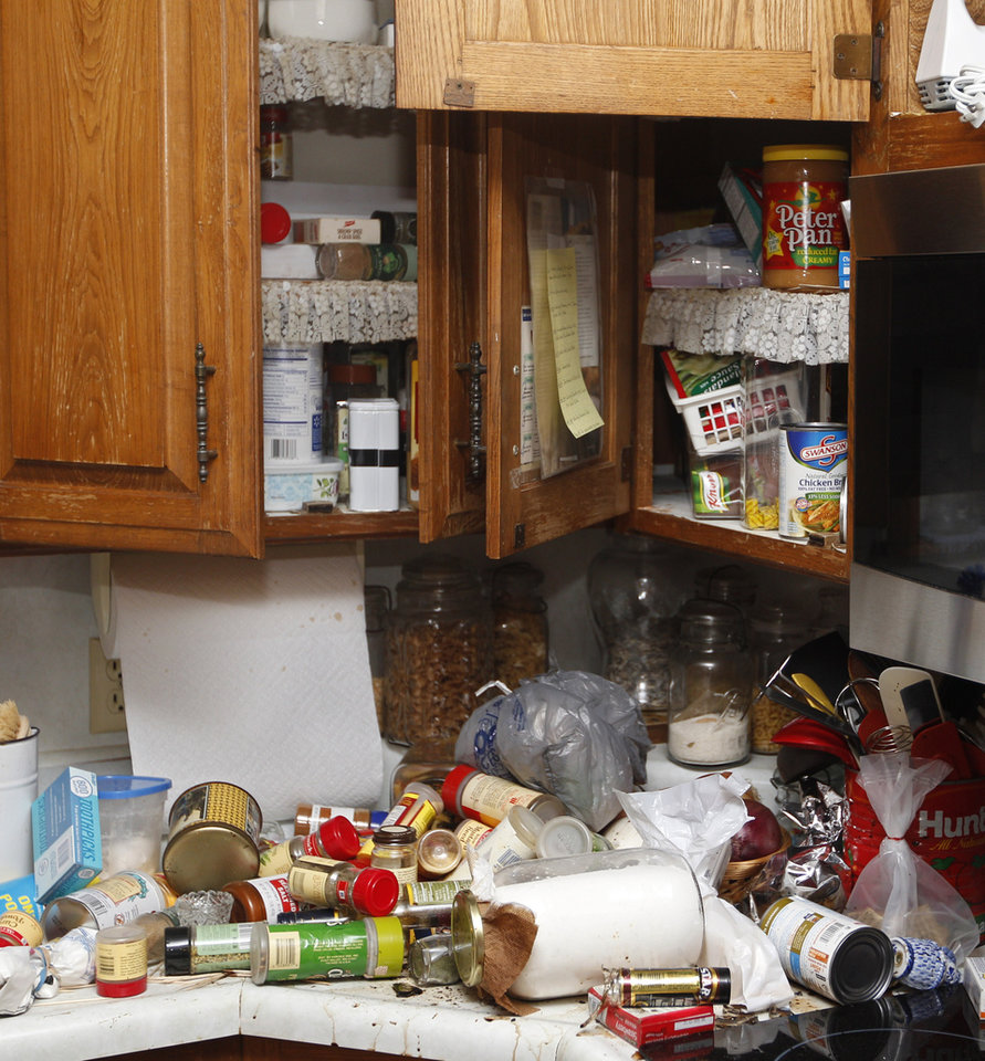 Contents of the kitchen cabinets in the home of Joe and Mary Reneau lie in disarray Sunday, Nov. 6, 2011, in Sparks, Okla., after having spilled out onto the countertops and floor following an earthquake. (AP Photo/Sue Ogrocki) ORG XMIT: OKSO106