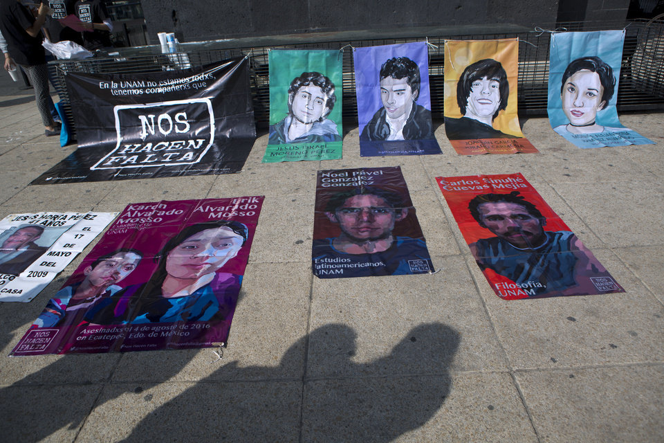"Photo - Passerby pause to look at posters showing some victims of the Mexican drug war, on the 10th anniversary of its start, at the Monument  for the the Mexican Revolution, in Mexico City, Sunday, Dec. 11, 2016. Ten years after Mexico declared a war on drugs, the offensive has left some major drug cartels splintered and many old-line kingpins like Joaquin ""El Chapo"" Guzman in jail, but done little to reduce crime or violence in the nation's roughest regions.(AP Photo/Rebecca Blackwell)"