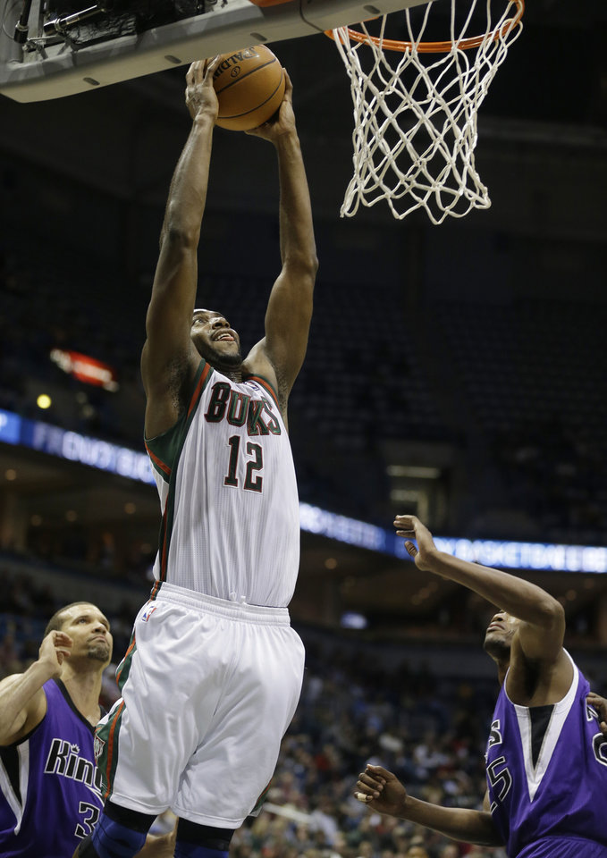 Photo - Milwaukee Bucks' Luc Richard Mbah a Moute (12) dunks the ball against Sacramento Kings during the second half of an NBA basketball game on Wednesday, Dec. 12, 2012, in Milwaukee. (AP Photo/Jeffrey Phelps)