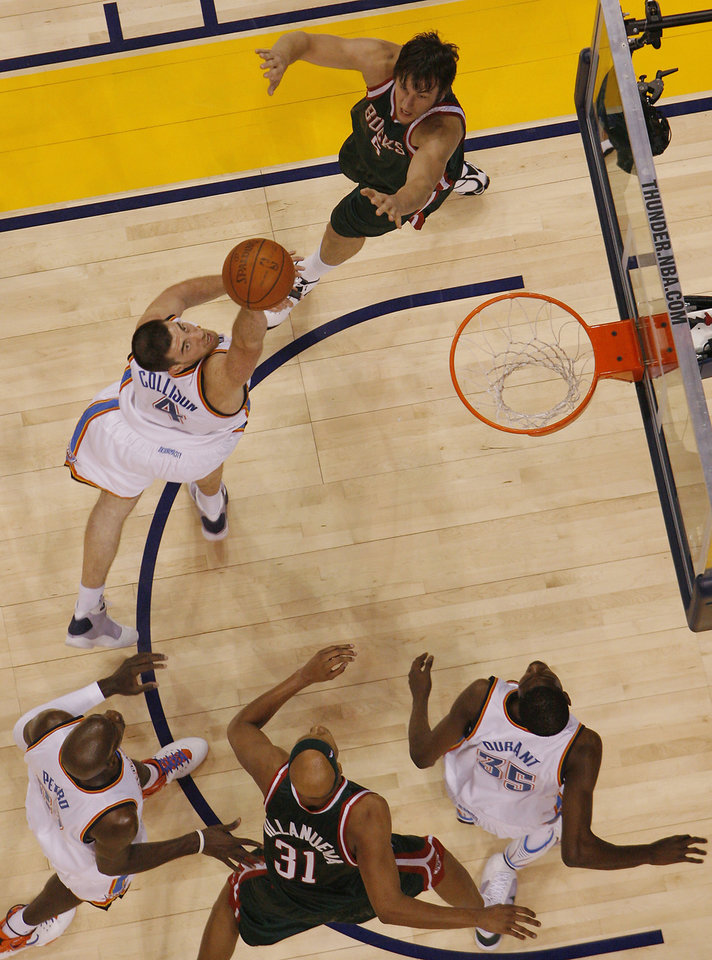 Nick Collison, of the Thunder, shoots against the Bucks' Andrew Bogut (6) during the first half of the opening night NBA basketball game between the Oklahoma City Thunder and the Milwaukee Bucks on Wednesday, Oct. 29, 2008, at the Ford Center in Oklahoma City, Okla.