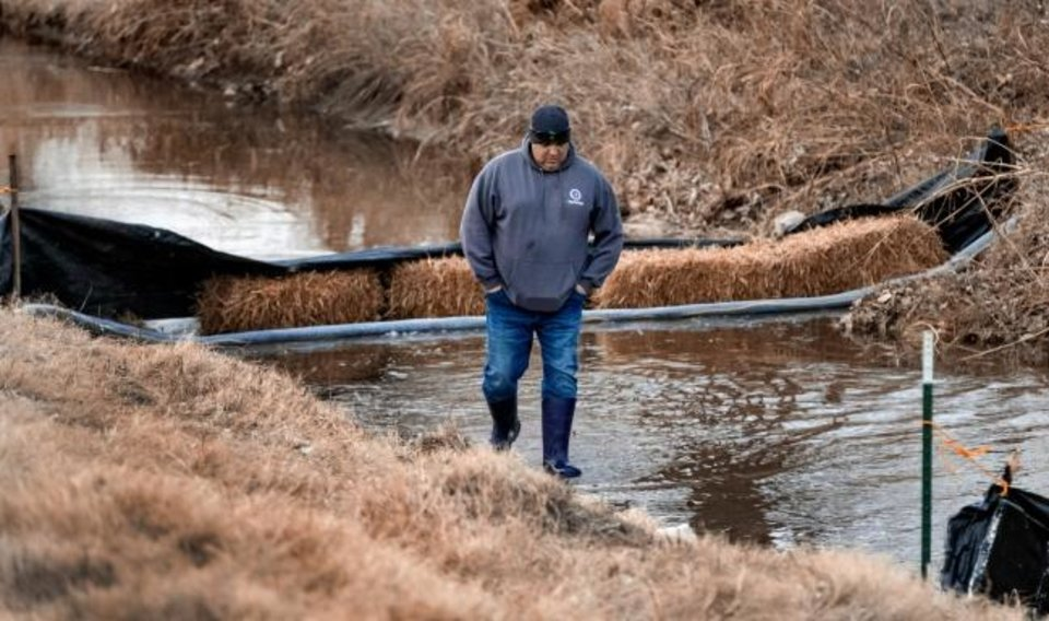 Photo -  City of Oklahoma City Field Supervisor Steven Wright checks the drainage ditch barriers used to catch debris as crews work to drain the mile-long Bricktown Canal in Oklahoma City, Okla Tuesday, Jan. 21, 2020. The canal holds 3 million gallons of water, and will take up to two weeks to clean out the silt and debris.   [Chris Landsberger/The Oklahoman]
