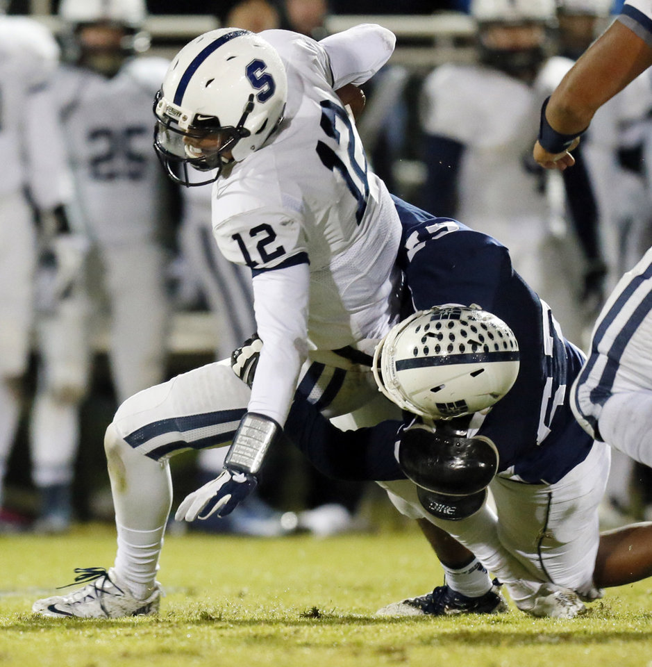 Casady's Timothy Giddings (67) sacks Foster Sawyer (12) of All Saints during a high school football game between Casady and Fort Worth All Saints Episcopal at Casady School in Oklahoma City,  Friday, Oct. 18, 2013. Photo by Nate Billings, The Oklahoman